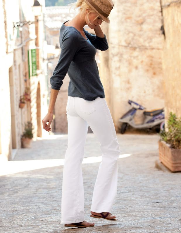 gray top paired with the white pants