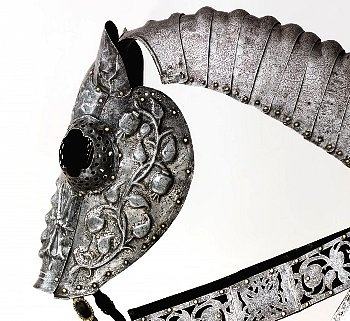 King Henry VIII's horse armor from the Emperor Maximilian I, c.1510. The scrolling tendrils bear the pomegranate badge of the House of Aragon, commemorating his marriage to Katherine in 1509.