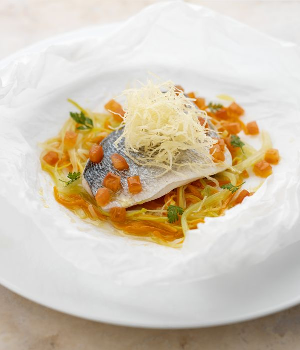 Carrots, courgettes, fennel and celery make a colourful bed for the sea bream, in this fish dish by Martin Wishart.