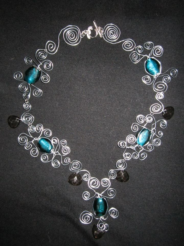 Handmade twisted metal necklace...check put our facebook page if interested http://www.facebook.com/twocutechicks?ref=hl
