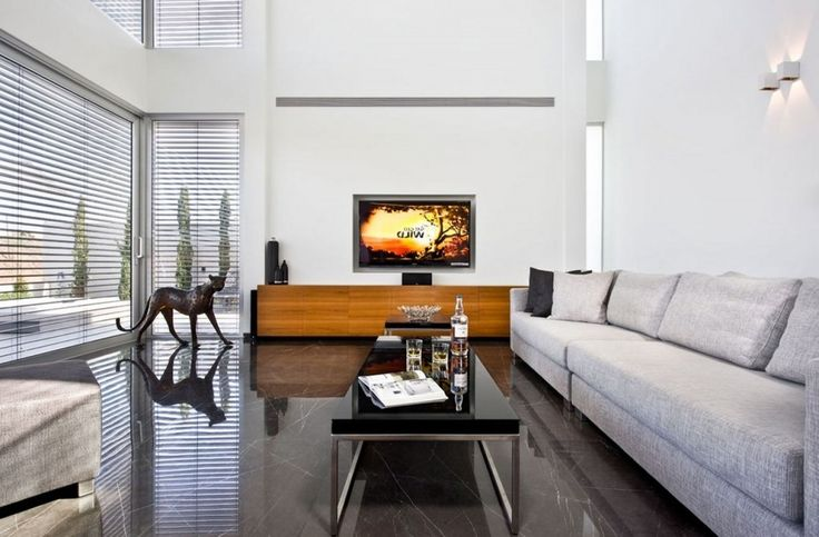 Villa: Reflective Coffeetable Mixedwith Light Grey Fabric Sofas Also Wooden Cabiner Plus Decorative Wall Lamp And Massive Glas Windows With White Blind: Exquisite Modern Villas Design