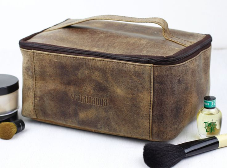 Our leather toiletries & cosmetic travel bag has a secure zipper around the top and opens to reveal a large compartment.  #vintage #leather #giftsforher