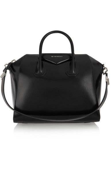 Black leather (Calf) Two top handles, detachable shoulder strap Designer plaque, silver hardware Internal zipped and pouch pockets Fully lined in black canvas Zip fastening along top  Comes with dust bag Weighs approximately 5.5lbs/ 2.5kg