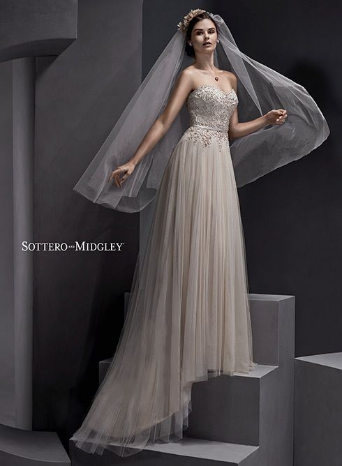 Tulle wedding dress with encrusted bodice and strapless, sweetheart neckline... Emsley by Sottero and Midgley.