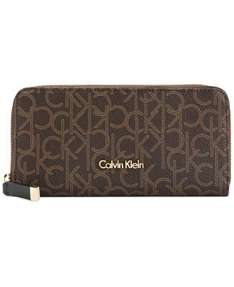 Organization with elegance. This luxe lovely from Calvin Klein will keep your credentials in signature style. Outfitted with the iconic Ck monogram, it flaunts multiple pockets and compartments for ef