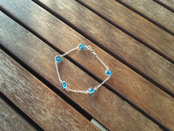 Check out this item in my Etsy shop https://www.etsy.com/listing/116753734/glass-evil-eye-silver-bracelet