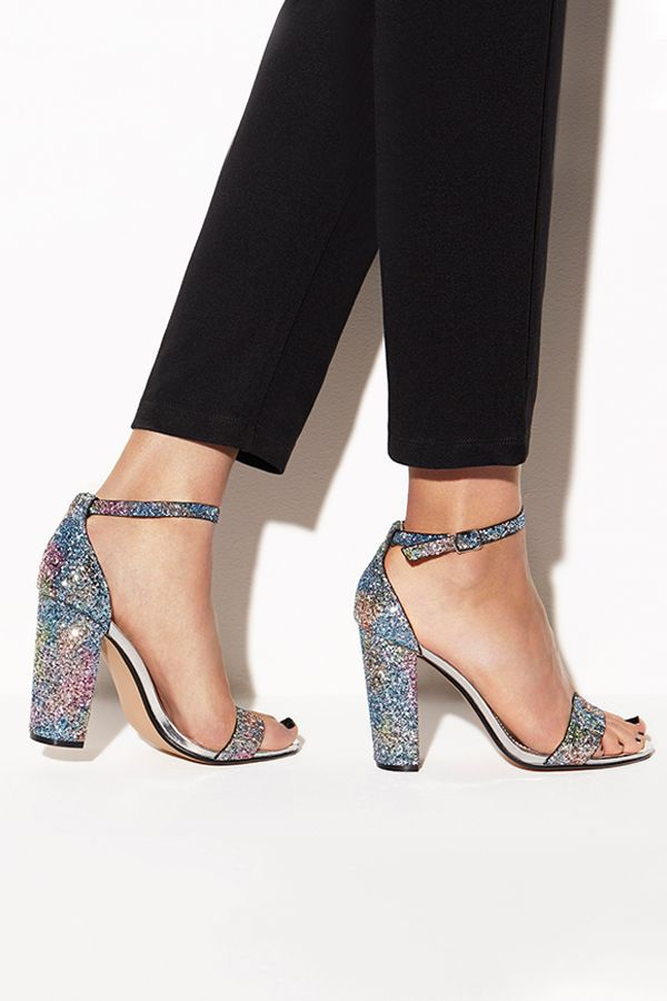 Steve Madden's stellar silver heels are destined for the dancefloor this festive season. Finished in light-reflecting multi-coloured sparkles, wear this soaring style to give an intergalactic spin to cropped black trousers.