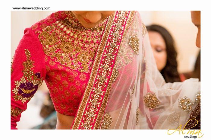 Pink with cream dupatta and a maharani neckline