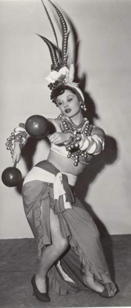 Lucy as; A Cuban dancer from 1950s, like Carmen Miranda not so long, shes' stepping on the bottom of her skirt !
