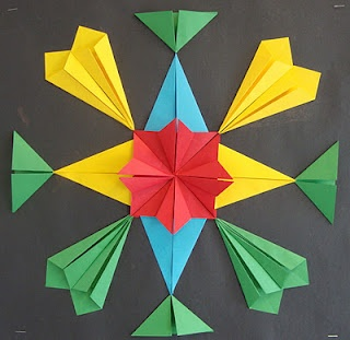 Here's a post with some ideas for folding symmetrical origami creations.