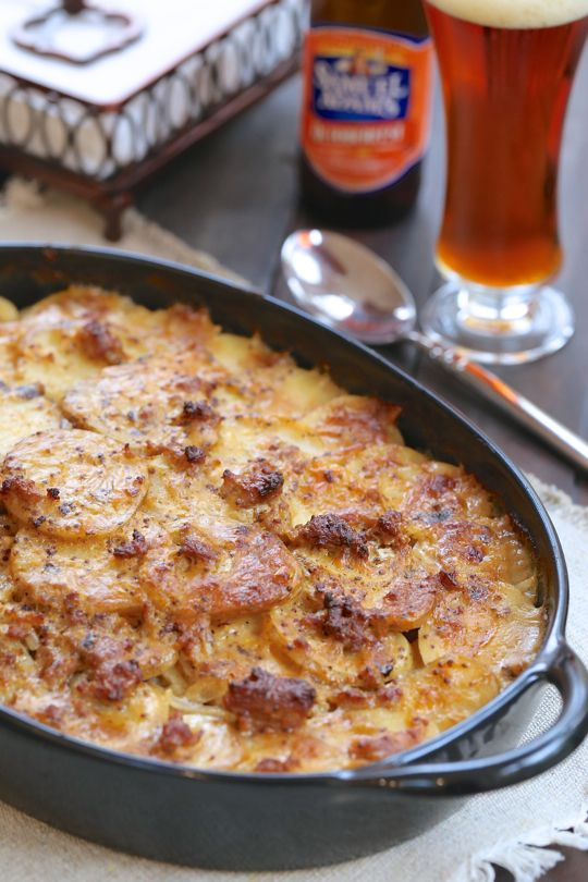 Octoberfest Potatoes - A decadent beer cheese sauce poured over sausage and potatoes baked until hot and bubbly!