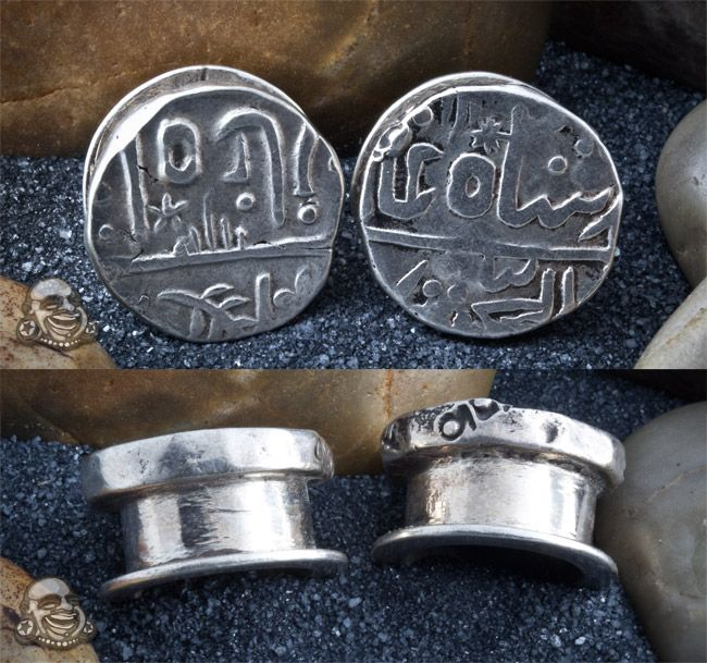Beautiful silver plugs made from ancient coins.