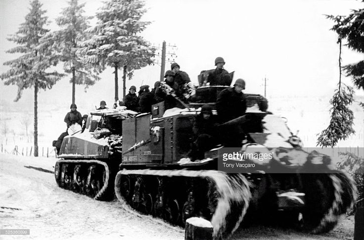 Tank convoy through the Ardennes, Belgium during the Battle of the Bulge, World War II, January 1945.
