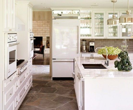 Love the new shiny sleek white appliances trend. {We bought new white appliance's & love the look too!} Love this stone floor with them too!