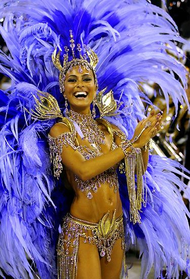 beautiful blue carnival costume with huge feathers and bling