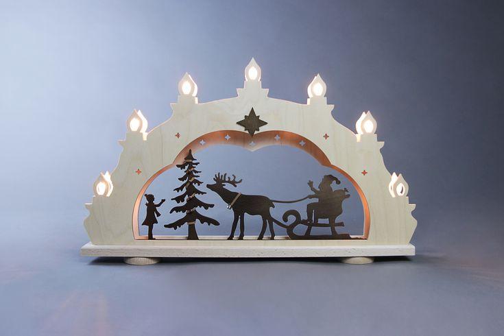 """Schwibbogen Rustikal Weihnachtsmann auf Schlitten  7 flg. #Erzgebirge #Holzkunst #Volkskunst #Weihnachtsmann #SantaClaus #Weihnachten  Der Schwibbogen """"Weihnachtsmann auf Schlitten """" Rustikal ist ein sehr beliebtes Motiv zur Weihnachtszeit. Am Fenster ist er mit seinen kleinen Laternchen, in welchen die Kerzen versteckt sind, ein echter Blickfang. Die..."""