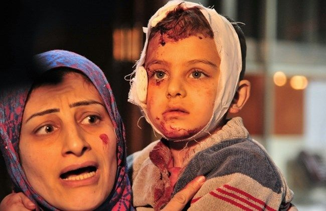 """SYRIA and IRAQ NEWS UPDATE: As Bombing Deaths Mount, US/Russia Agree to Partial """"Ceasefire"""" - But Can it Realistically Hold? *For More #Iraq and #Syria News ...* http://www.petercliffordonline.com/syria-and-iraq-news PIC: Woman Carries Injured Child Hurt in IS Suicide Bomb Attack in Damascus:"""