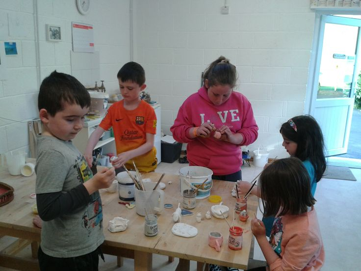 Daniel, Zach, Joanne, Eirinn and Holly finally getting their hands on their bisque fired pieces… glazing at last!!