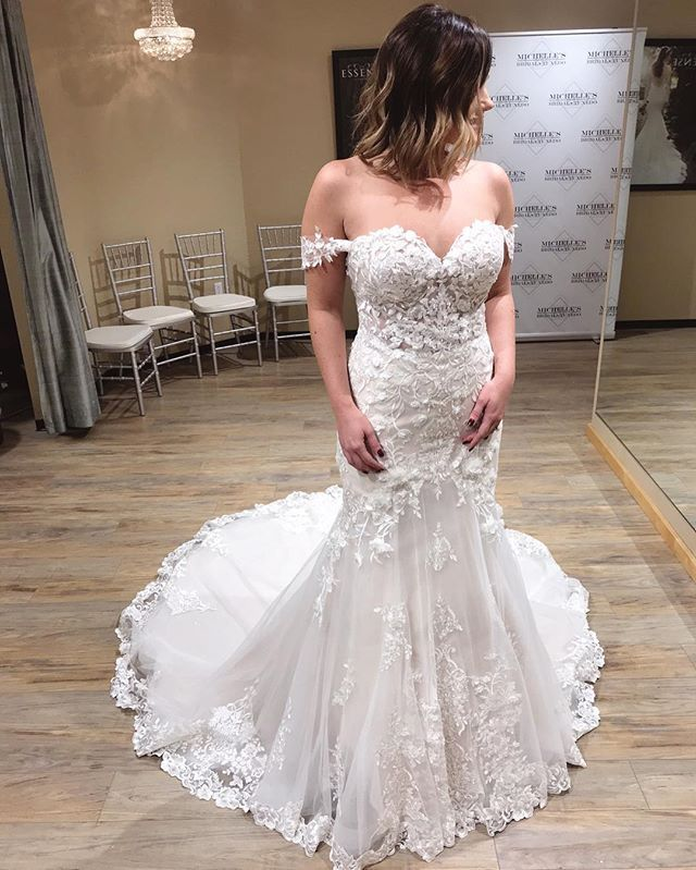 82624e23cc0 This silver embroidered wedding dress with off-the-shoulder straps from  Essense of Australia is the perfect mix of romantic and sexy.