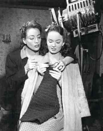 "Joan Crawford teaching Ann Blyth to knit on ""Mildred Pierce."""