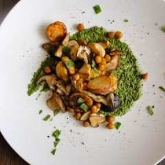 Mushroom, potato & pumpkin seed has served over spinach pesto puree