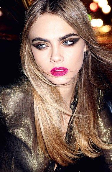 Cara Delevingne with a dramatic winged smokey eye & bright pink lip #beauty #hair #makeup