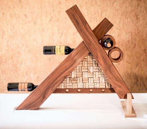 Porta botellas : Hogar de estilo  por Stann Designs S.A de C.V. https://www.homify.com.mx/proyectos/429541/cavas-para-vino
