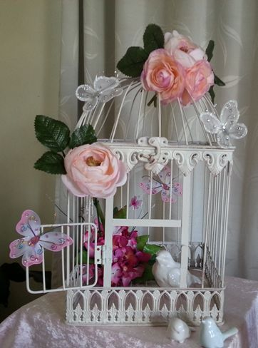 Beautiful bird cages in different sizes and shapes.  www.thechocandrock.com, www.facebook.com/thechocandrocklollybuffet