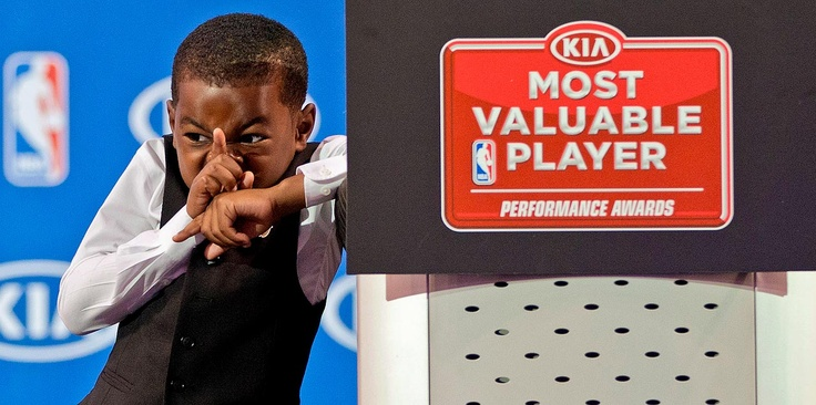 Shhhhhhhhhhhhhhhhhhh! Miami Heat's LeBron James' son, Bryce, reacts as his father speaks during an NBA news conference, Sunday, May, 5, 2013, in Miami. James was formally announced as having won his fourth Most Valuable Player award Sunday. (AP Photo/J Pat Carter)  Lebron James wins MVP