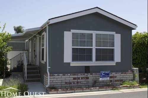 Mobile home dark gray exterior color with white trims for Renovation exterieur mobil home