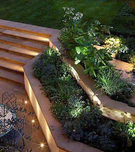Tiered garden w/ 1w movable LED lights.  I would love to do this in our front landscaping! Gorgeous.