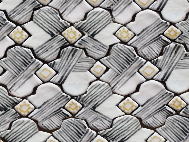 Handmade and painted ceramic tiles, arabesque pattern in striped black, yellow and white