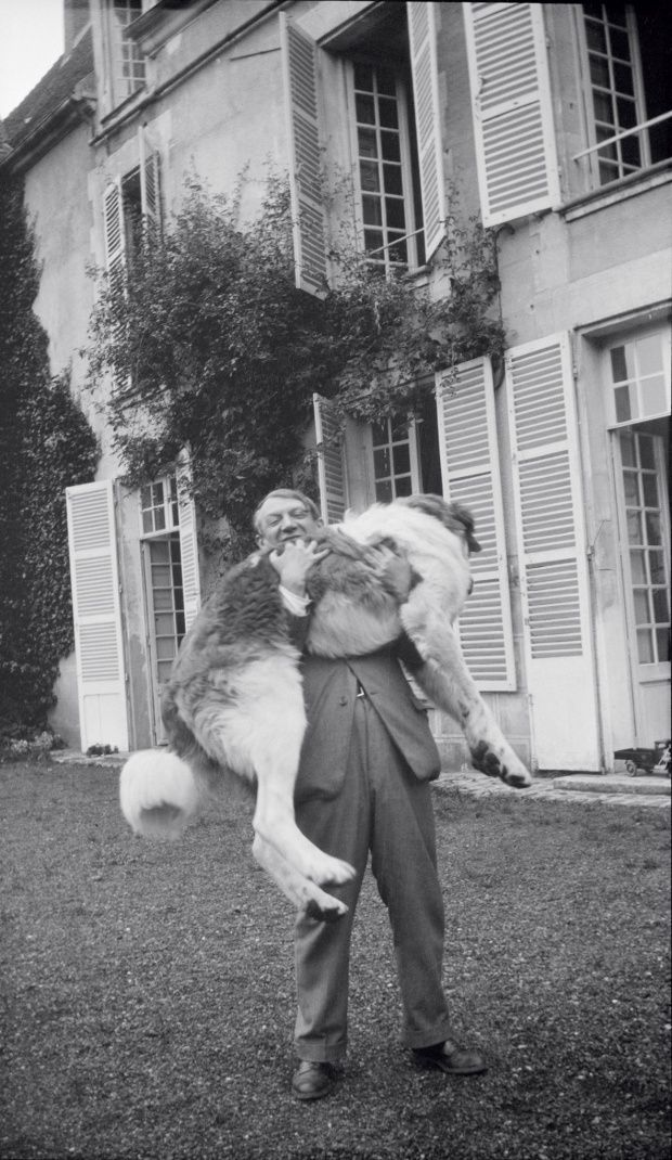 Picasso with one of his dogs in 1932.