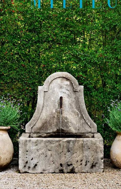 """""""A French 19th-century stone fountain."""" Houston home of Andrew and Annette Schatte. Photography by Peter Vitale"""