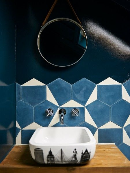 A dark painted bathroom.