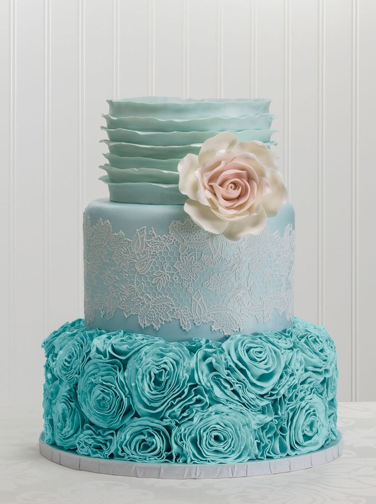 Fondant ruffles, cake lace, rosettes, and a gum paste ...