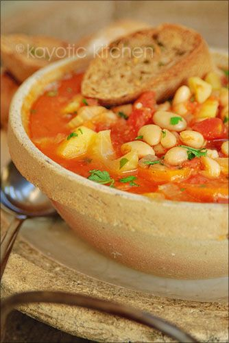 Ribollita - A Tuscan soup.  Main ingredients:  4 celery stalks, 1 large onion, 2 carrots, 1 medium potato,  2 large garlic cloves  1 can diced tomatoes (14oz)  1 can white beans (14oz)