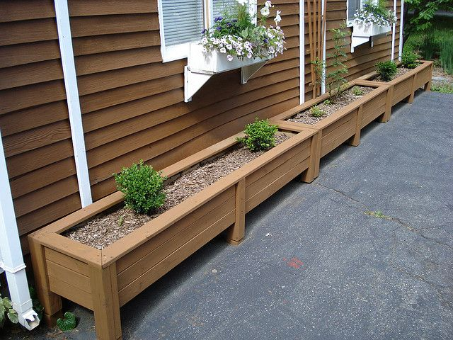 Long row of DIY outdoor planters for our patio.