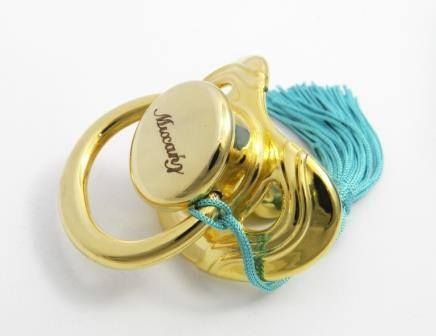 Baby pacifier coated with gold 24K, with baby's name engraved on it.