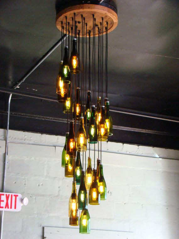 This was a custom 25 light wine bottle chandelier. There are 25 wine bottle lights hanging in a long spiral. The ceiling mount is 2 feet in circumference