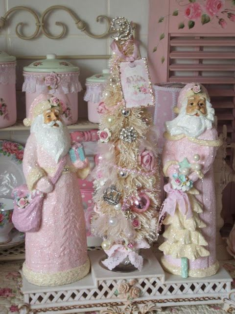Olivia's Romantic Home: Pink Christmas in July - love these pink Santa figurines. They look similar to ones I collect...