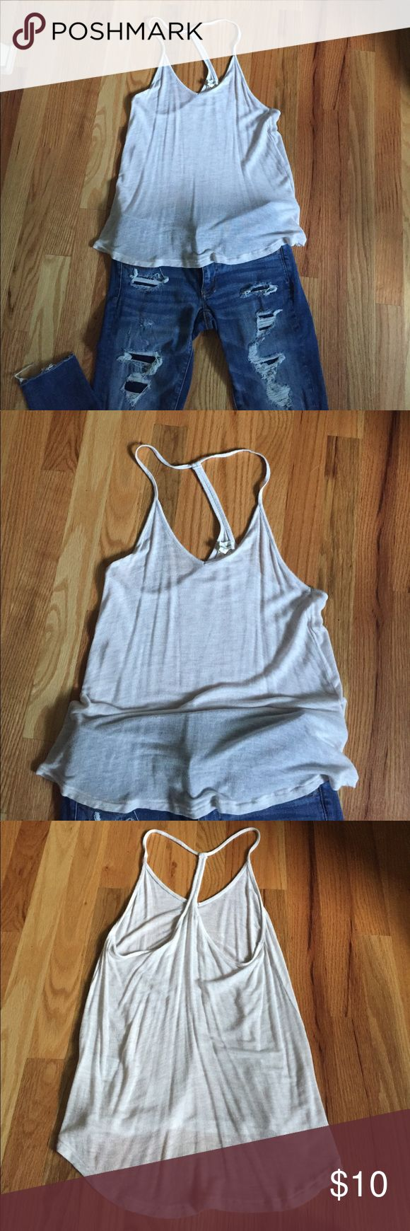 Razor back tank Razor back see through tank top from Urban. It's never never been worn. It's supper cute paired with a bralette underneath. It's perfect for the summer. You can even just wear it over a bathing suit top. Material: 95% rayon and 5% spandex(super comfy) Urban Outfitters Tops Tank Tops