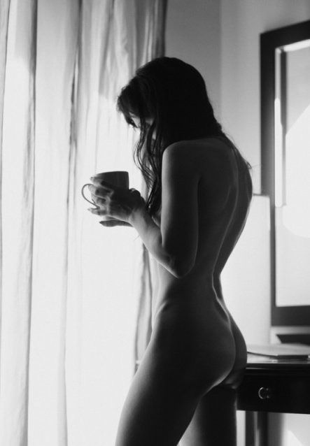 Naked woman drinking morning coffee for that