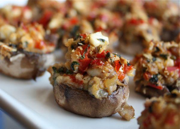 Stuffed Mushrooms using feta, parmesan, spinach, panko crumbs, red bell pepper and seasonings.