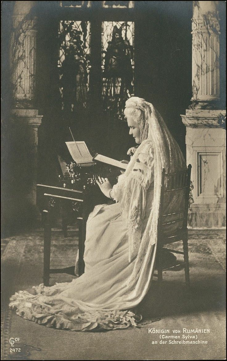 """Elizabeth of Wied became Queen of Romania as the wife of King Carol I.  In this photo she is wearing a white mourning veil and working at a typewriter.  Elizabeth wrote prolifically  under the pen name """"Carmen Sylva""""."""