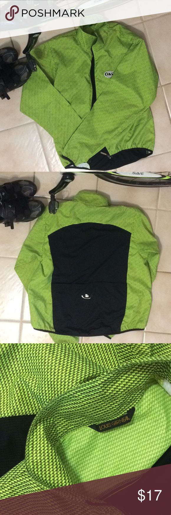 Louis Garneau wind jacket Vintage Louis Garneau wind jacket — very cool neon green and black to make sure you're hi-viz while riding. Jacket shell is moisture-resistant with breathable back panel. Brushed interior front panels help keep the wind at bay. Full zip and high, firm collar. Black trim with not-too-tight elastic at cuffs and hem. With three drop packets. Louis Garneau Jackets & Coats