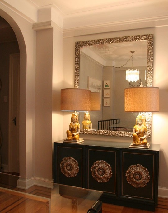 Black Hollywood Regency credenza...love the lamps & mirror too!