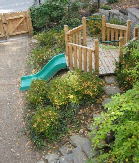 Oct. 2009: Shrubs had begun to mature and the embankment slide was well used at Wellesley College CSC. (Photo by Eleanor Luken)