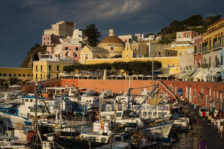 Landscape of Ponza at sunset, when the boats return after a day spent sailing close to its amazing coast and fishermen are preparing boats for the night fishing...