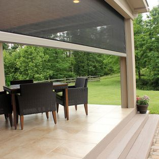 Retractable Patio/Lanai Screens - Porch with large retractable screens, a fully screened off haven